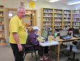 Red Feather Library Director Creed Kidd stands by the main computer use area
