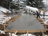 IMG: Crew members pour concrete at DeltaCom's Blountville/Bristol site