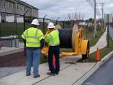 A KINBER construction crew prepares a spool of fiber for deployment