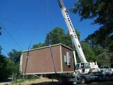 A MBC crew installs a pre-fabricated hut
