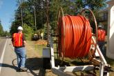 Construction workers lay fiber along Merit's 2,287 mile fiber optic network