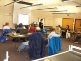Image: A staff member teaches visitors Internet security tips