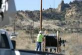 NTUA crew member strings fiber network lines in New Mexico.