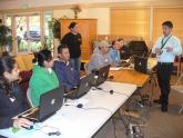IMG: Residents from a housing community in San Jose, Calif. attend a computer ba
