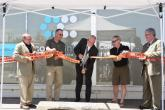 Officials cut a ribbon at the Pend Oreille's construction ceremony
