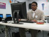 A Boys & Girls Club Youth member hard at work on a computer