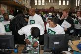 volunteers refurbishing computers