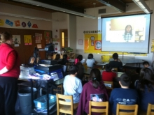 A class from Angoon City School watches a Digital Storytelling presentation