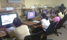 Participants at the Boat People SOS computer center in Bayou La Batre, Ala.
