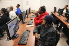 Students attend a computer class at the Dearborn Homes Technology Center