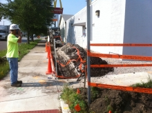 A construction crew member oversees the upgrade of existing fiber
