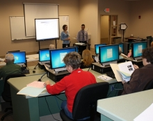 Image: Two instructors lead an Internet fundamentals course