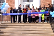 IMG: Visitors gather for a ribbon cutting ceremony
