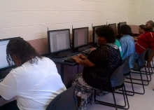 A group of students use computers to learn digital literacy skills