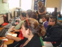 Parents and children learning at computers