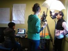 Three ReelGrrls students film a stop-animation scene for their project